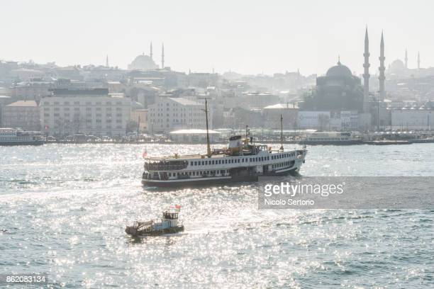 Dreamy high view of Istanbul city with mosque towers and sea with boats