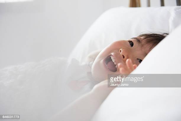 dreamy portrait of little girl in the bed