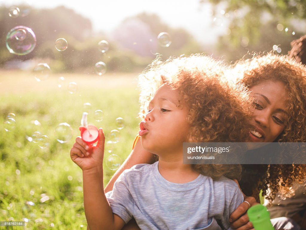 Dreamy soft intimate moment between a mother and her boy : Stock Photo