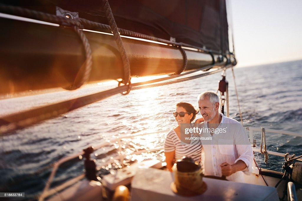 Dreamy vintage shot of senior couple enjoying a leasure cruise : Stock Photo