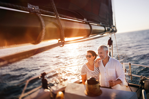 Dreamy vintage shot of senior couple enjoying a leasure cruise 518833784