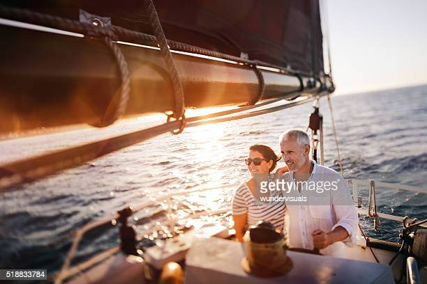 dreamy vintage shot of senior couple enjoying a leasure cruise - yacht stock pictures, royalty-free photos & images