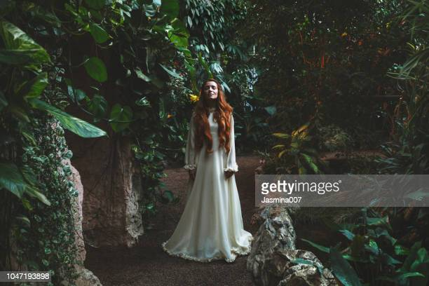 dreamy woman in tropical environment - long dress stock pictures, royalty-free photos & images