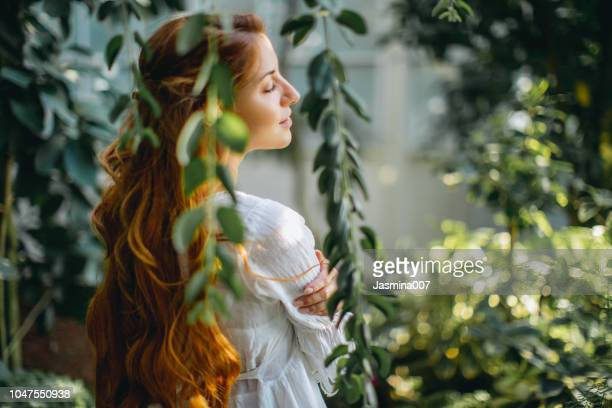 dreamy woman in tropical environment - zen like stock pictures, royalty-free photos & images