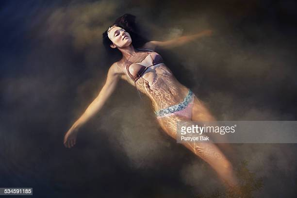 Dreamy Woman Suspended in Cloudy Water