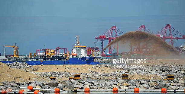 Dredger pumps sand to reclaim land just outside the Colombo port on November 23 as part of a $1.4 billion real estate development by China. The...