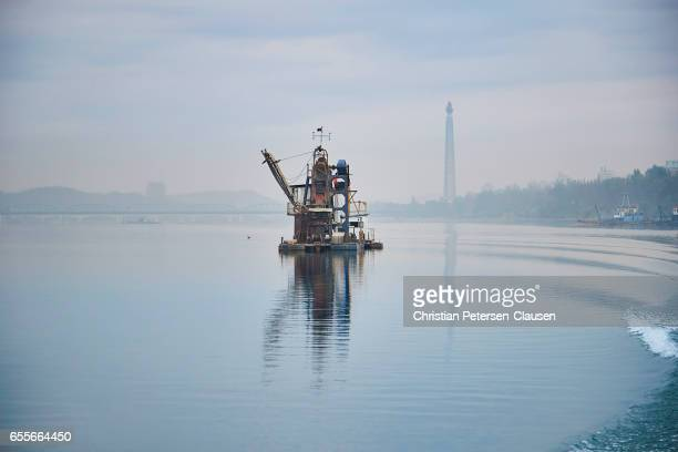 Dredging barge and Juche Tower on Taedong River