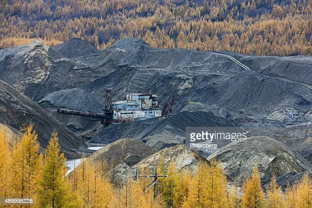 A dredging boat excavates rock on a river during placer gold mining operations at the Lenzoloto OJSC plant a unit of Polyus Gold International Ltd...