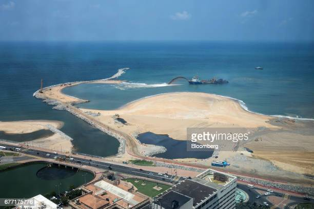 A dredging vessel operates at the construction site for the Colombo Port City development in Colombo Sri Lanka on Friday April 21 2017 Once fought...