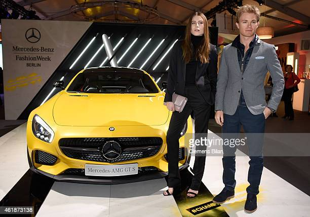 Dree Hemingway and Nico Rosberg pose next to the Mercedes-AMG GT S the Mercedes-Benz Press Vernissage during the Mercedes-Benz Fashion Week Berlin...