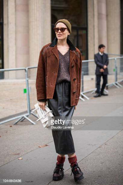 Dree Hemingway wearing a brown sweater brown suede jacket black leather skirt brown shoes and white Miu Miu bag is seen after the Miu Miu show on...