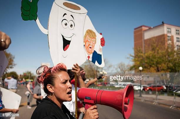 Dreena Gonzales of Pueblo protests outside of a rally for Donald Trump held at the Pueblo Convention Center on October 3 2016 in Pueblo Colorado...