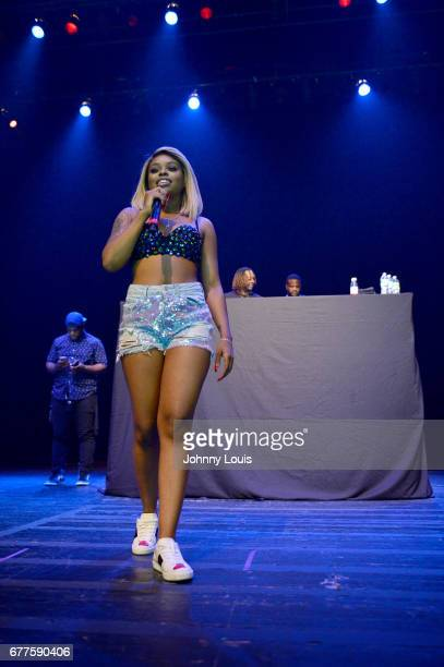 Dreezy performs onstage during the Gucci Mane Trap God Tour concert at Fillmore at Jackie Gleason Theatre on May 2 2017 in Miami Beach Florida