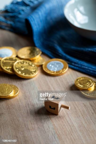 dreidel and chocolate coins for hanukkah - dreidel stock photos and pictures