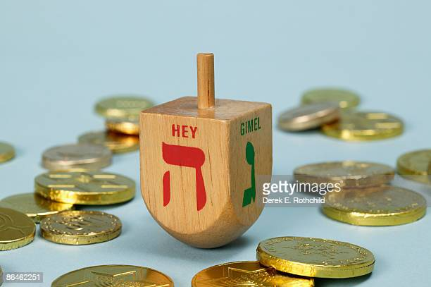 dreidel and gelt - dreidel stock photos and pictures