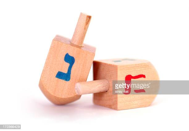 dreidels in macro - dreidel stock photos and pictures