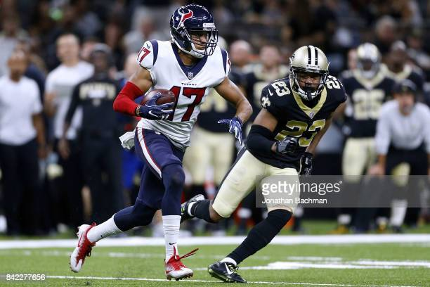 Dres Anderson of the Houston Texans runs past Marshon Lattimore of the New Orleans Saints during the first half of a preseason game at the...