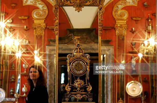 A visitor looks at precious exhibits of the restored Green Vault after its official inauguration at Dresden's Royal Palace 01 September 2006 It has...