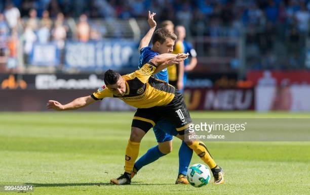 Dresden's Aias Aosman and Bochum's Thomas Eisfeld vying for the ball during the 2nd Bundesliga match pitting VfL Bochum vs Dynamo Dresden in Bochum...