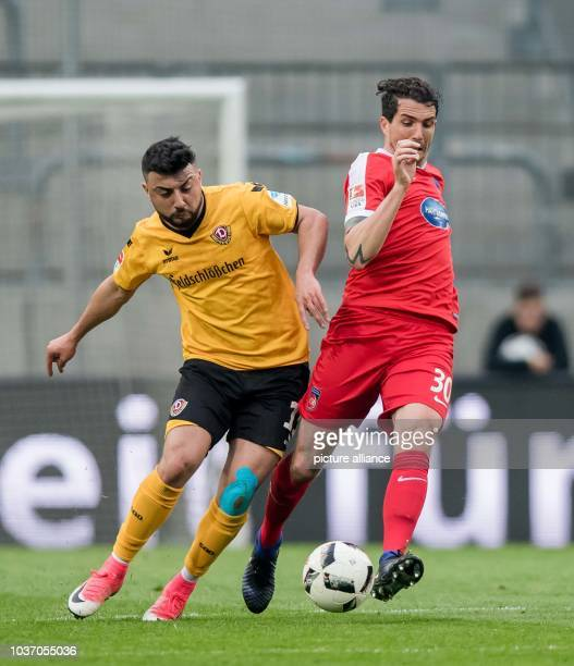 Dresden's Aias Aosman and Heidenheim's Norman Theuerkauf vie for the ball during the German 2nd divisionBundesliga soccer match between SG Dynamo...
