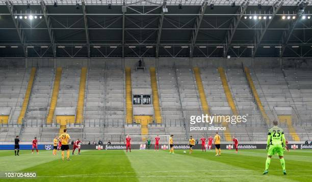 Dresden's Aias Aosman and Niklas Hauptmann seen during kickoff in front of the empty Kblock at the German 2nd divisionBundesliga soccer match...
