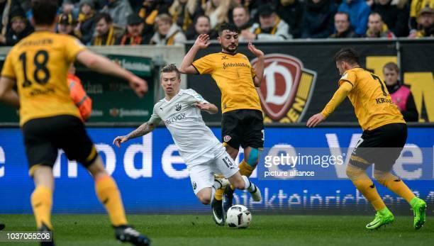 Dresden's Aias Aosman and Sandhausen's Jakub Kosecki vie for the ball during the German 2 Bundesliga soccer match between SG Dynamo Dresden and SV...