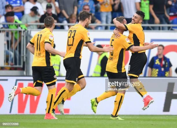 Dresden's Haris Duljevic Florian Ballas scorer Manuel Konrad and Aias Aosman cheer over the 21 score during the German 2 Bundesliga match between SV...