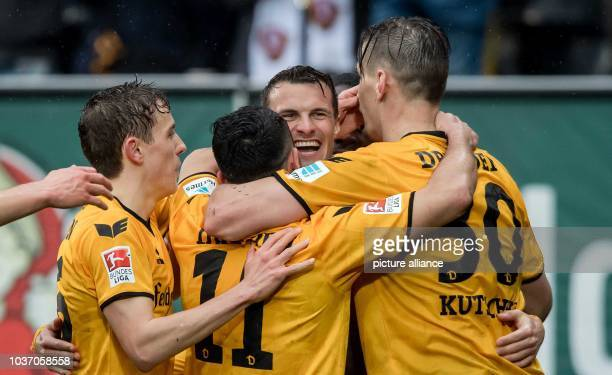 Dresden's Philip Heise cheers over his 20 score with Jannik Müller Aias Aosman and Stefan Kutschke during the German 2 Bundesliga soccer match...
