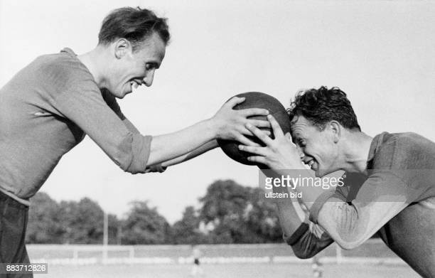 Soccer player Willibald Kress and Helmut Schoen during training in the Berlin Olympic stadium