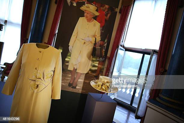 A dress and coat designed by Angela Kelly Couture and a hat by Rachel TrevorMorgan all worn by Queen Elizabeth II for a garden party are shown at The...