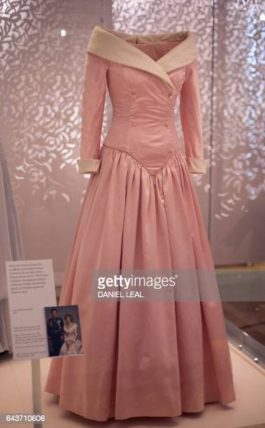 A dress by designer Catherine Walker and worn by Britain's Diana Princess of Wales during an official portrait with her husband Charles Prince of...