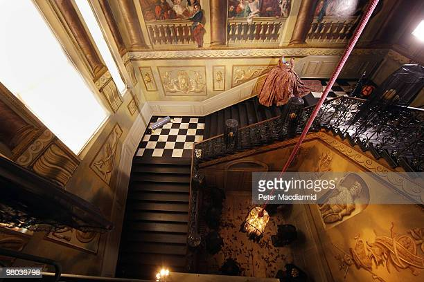 Dress by Vivienne Westwood stands at the top of the staircase in the Room of Flight the Enchanted Palace experience at Kensington Palace on March 25,...