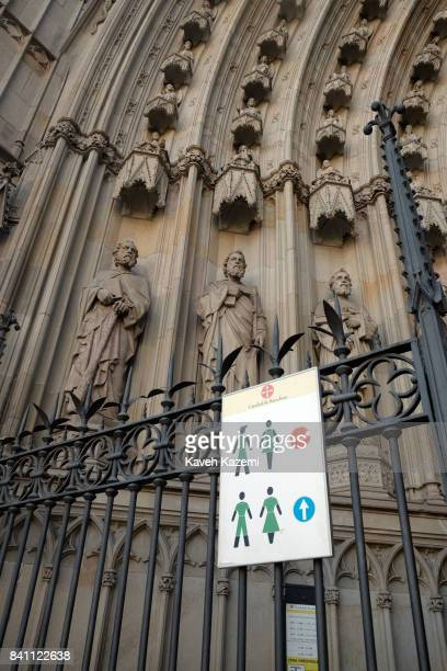 A dress code sign is displayed on the gate at the entrance of Barcelona Cathedral on July 12 2017 in Barcelona Spain The Cathedral of the Holy Cross...