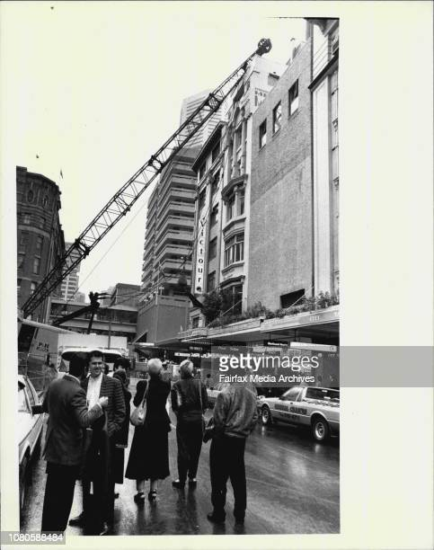Dress designer an clothing executive Merivale with some of her evacuated staff in Pitt Street city today July 06 1987
