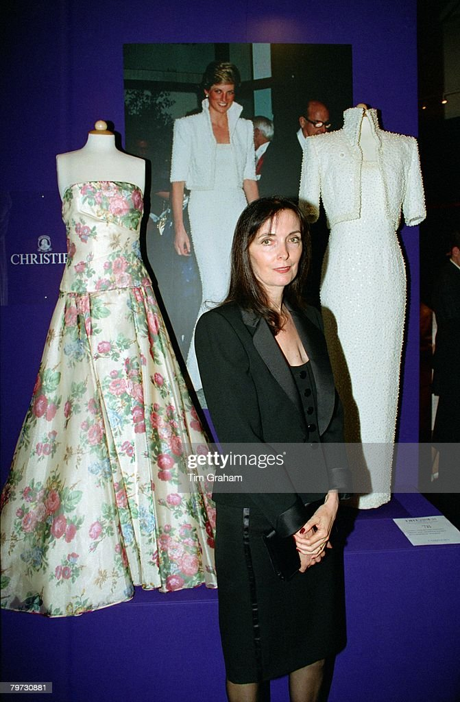 Dress designer Catherine Walker posing in front of one of he : News Photo