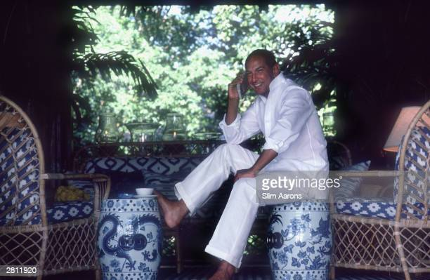 Dress designer Oscar De La Renta relaxes in the living room of his apartment the Casa de Madera in the resort of Casa de Campo in the Dominican...