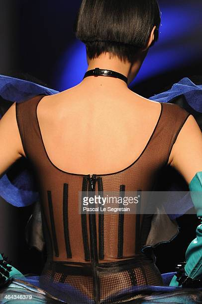 A dress detail is seen a model walks the runway during Jean Paul Gaultier show as part of Paris Fashion Week Haute Couture Spring/Summer 2014 on...