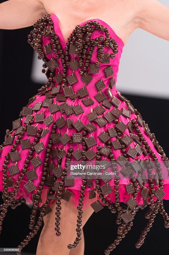 Dress detail of Actress and TV presenter Annabelle Milot as she walks the runway and wears 'La Deesse Chocolatee', a chocolate dress made by designer Nathalie Vigne and chocolate maker Francois Pralus, during the Fashion Chocolate Show at Salon du Chocolat at Porte de Versailles, in Paris.