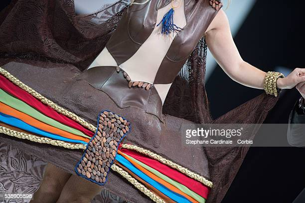 Dress detail of Singer Christelle Chollet is seen as she walks the runway and wears 'Les Pouvoirs du Chocolat' a chocolate dress made by Wanderson...