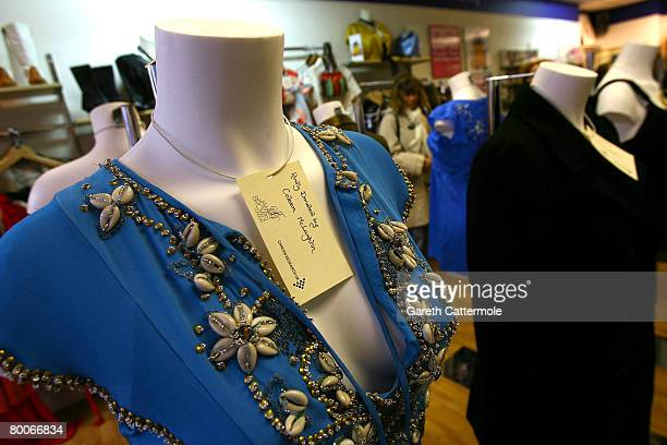 A dress donated by Colleen McLoughlin stands on display inside the Cancer Research UK shop on Marylebone High Street during the Make Today Count...