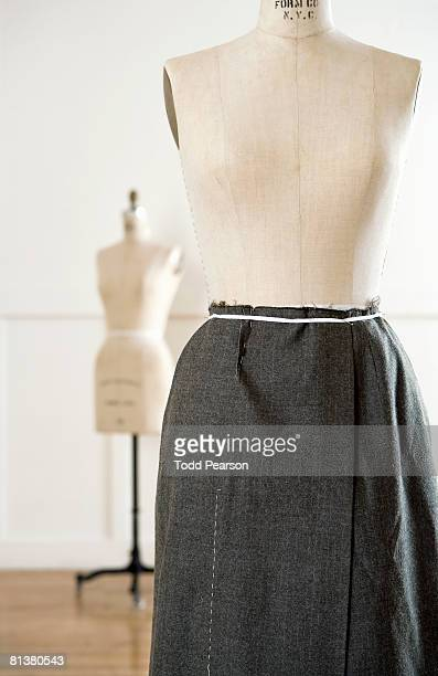 dress form wearing skirt - dressmaker's model stock photos and pictures
