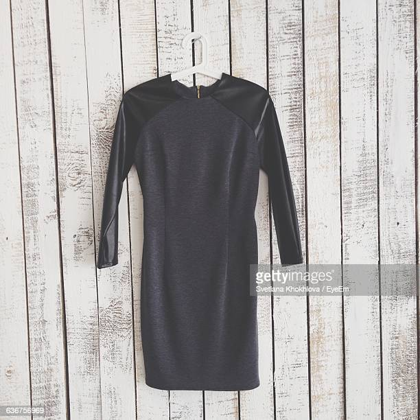 Dress Hanging From Coathanger On Wooden Wall