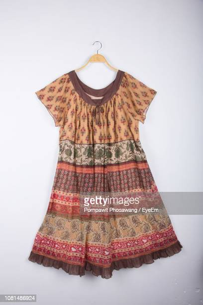 dress hanging on coathanger against white background - cut out dress stock pictures, royalty-free photos & images