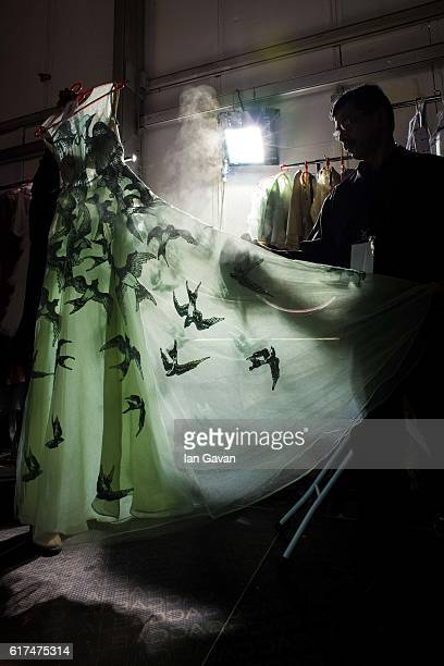 A dress is steamed backstage ahead of the Amal Al Raisi show during Fashion Forward Spring/Summer 2017 at the Dubai Design District on October 23...