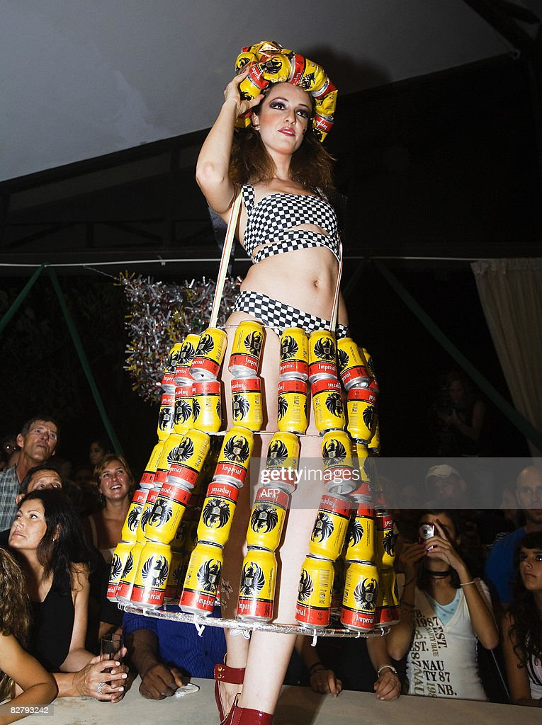 A Dress Made From Recycled Beer Cans With A A Matching Hat