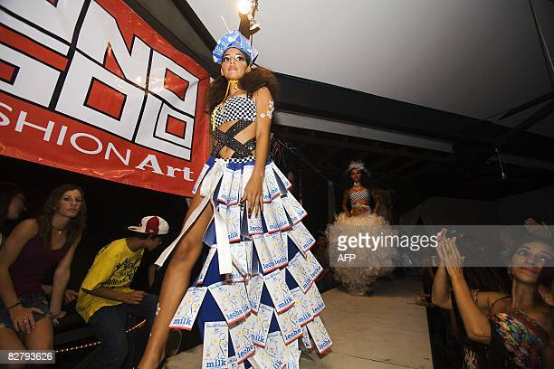 Dress made from recycled milk cartons is shown during the Trashion Fashion show in Tamarindo, Costa Rica, on September 11, 2008. The show was...
