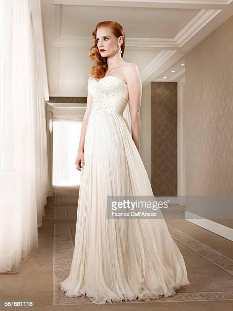 Dress of chiffon by Giorgio Armani and diamond earrings by Chopard