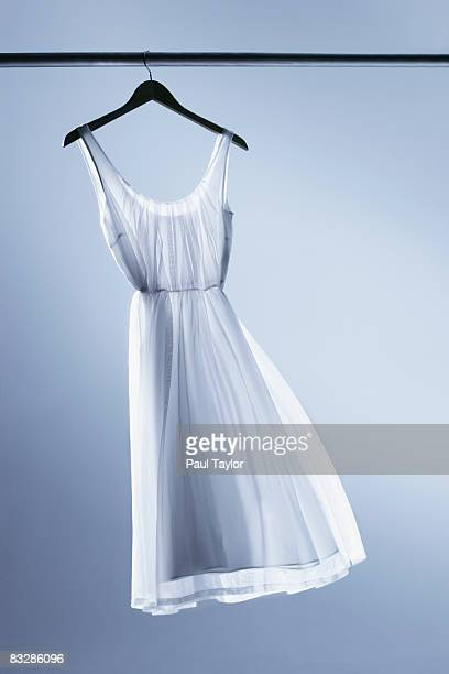 dress on hanger - kleid stock-fotos und bilder