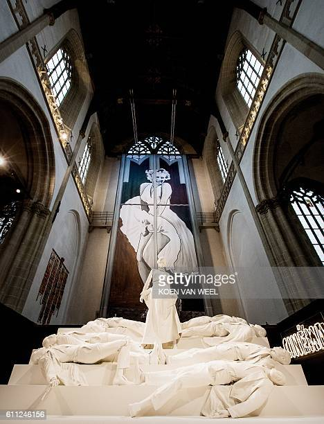 A dress owned by US actress Marilyn Monroe is displayed during the exhibition 90 Years Miss Monroe Reflecting on a Female Icon at the New Church in...