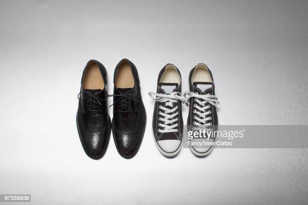 dress shoes and canvas sneakers - pair stock pictures, royalty-free photos & images
